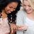 a happy woman is showing her friend her wedding ring stock photo © wavebreak_media
