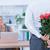 businessman hiding flowers behind back for colleague stock photo © wavebreak_media