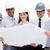 Multi-ethnic group of architects wearing hardhats stock photo © wavebreak_media