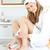 Happy caucasian woman varnishing her toenails in the bathroom at home stock photo © wavebreak_media