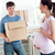 smiling man with cardboard looking at his pregnant wife standing in their new kitchen during removal stock photo © wavebreak_media