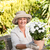 Senior woman with flowers in her garden stock photo © wavebreak_media