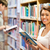 mosolyog · diák · tart · könyv · könyvtár · oktatás - stock fotó © wavebreak_media