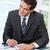 бизнесмен · глядя · ноутбука · рабочих · статистика · бизнеса - Сток-фото © wavebreak_media