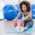 Sporty woman stretching hands to legs in fitness studio stock photo © wavebreak_media