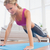 strong blonde in plank position on exercise mat stock photo © wavebreak_media