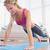 młoda · kobieta · posiedzenia · wykonywania · równoważenie · poduszka · salon - zdjęcia stock © wavebreak_media