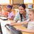 Cute pupils in computer class with teacher  stock photo © wavebreak_media