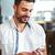 smiling man on the phone having coffee stock photo © wavebreak_media