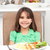 cute little girl eating pasta and salad in the kitchen stock photo © wavebreak_media