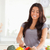 Lovely woman cooking vegetables while standing in the kitchen stock photo © wavebreak_media