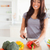 Charming female cooking vegetables while standing in the kitchen stock photo © wavebreak_media