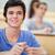 öğrenci · dinleme · bakıyor · kamera · mutlu - stok fotoğraf © wavebreak_media