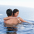 smiling couple playing together in a swimming pool stock photo © wavebreak_media