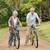 idős · pár · bicikli · vidék · teljes · alakos · nő · fű - stock fotó © wavebreak_media