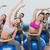 sporty women stretching hands on exercise balls at gym stock photo © wavebreak_media