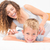 happy mother tickling her cute son on bed stock photo © wavebreak_media