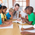 Teacher and pupils working at desk together stock photo © wavebreak_media
