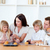 Cheerful family eating muffins in the kitchen stock photo © wavebreak_media