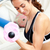 Young athletic woman holding a dumbbell in her living-room at home stock photo © wavebreak_media