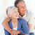 Senior couple hugging on their bed at home stock photo © wavebreak_media