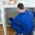 Repair man measuring something in a kitchen stock photo © wavebreak_media