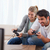 Cheerful couple playing video games in their living room stock photo © wavebreak_media