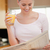 Portrait of a woman reading the news while drinking orange juice in her kitchen stock photo © wavebreak_media