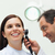 Doctor using an otoscope to look at the ear of a patient in an examination room stock photo © wavebreak_media