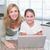 uśmiechnięty · matka · córka · za · pomocą · laptopa · wraz · domu - zdjęcia stock © wavebreak_media