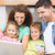 happy family sitting on sofa using laptop together to shop onlin stock photo © wavebreak_media