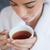 fiatal · nő · fehér · fürdőköpeny · kávé · társalgó · nappali - stock fotó © wavebreak_media