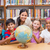 cute pupils and teacher looking at globe in library stock photo © wavebreak_media