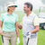 happy golfing couple facing each other with golf buggy behind stock photo © wavebreak_media