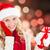 composite image of happy festive blonde with gift stock photo © wavebreak_media