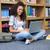 улыбаясь · женщины · студент · используя · ноутбук · библиотека · портрет - Сток-фото © wavebreak_media