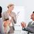 smiling business people applauding a good presentation stock photo © wavebreak_media