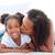 loving woman kissing her daughter lying down on bed stock photo © wavebreak_media