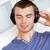 młody · człowiek · słuchanie · muzyki · słuchawki · portret · uśmiech · twarz - zdjęcia stock © wavebreak_media