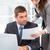 два · деловые · люди · глядя · бумаги · рабочих · ноутбука - Сток-фото © wavebreak_media