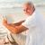 man reading a book on the beach stock photo © wavebreak_media