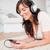 csinos · barna · hajú · nő · zenét · hallgat · mp3 · lejátszó · szőnyeg - stock fotó © wavebreak_media