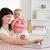 cute brunette woman relaxing with her laptop next to her baby while sitting in the kitchen stock photo © wavebreak_media