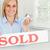 szőke · nő · üzletasszony · mutat · miniatűr · ház · eladva - stock fotó © wavebreak_media