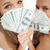 High-angle view of two young woman behind dollars against white background stock photo © wavebreak_media