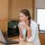 femme · tasse · regarder · ordinateur · cuisine - photo stock © wavebreak_media
