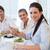 empresária · alimentação · sushi · sorridente · escritório - foto stock © wavebreak_media