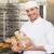 baker holding freshly baked loaves stock photo © wavebreak_media