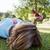 pretty woman lying down in park stock photo © wavebreak_media