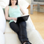 smiling woman surfing the internet lying on a sofa stock photo © wavebreak_media